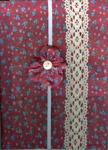 Cloth covered journal and embellished elastic bookmark.