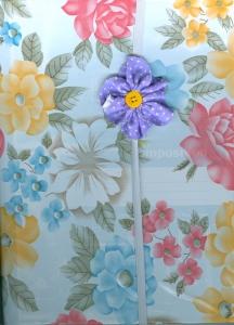 Vinyl covered journal with embellished elastic bookmark.