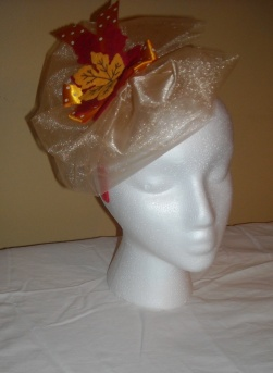 Gold and orange Fascinator