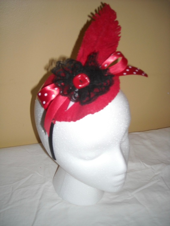 Red and black fascinator